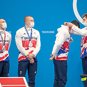 TOKYO, JAPAN - AUGUST 1:  The Great Britain team of Luke Greenbank, Adam Peaty, James Guy and Duncan Scott on the podium after winning the silver medal in the 4x100m Medley relay during the Swimming Finals nat the Tokyo Aquatic Centre at the Tokyo 2020 Summer Olympic Games on August 1, 2021 in Tokyo, Japan. (Photo by Tim Clayton/Corbis via Getty Images)