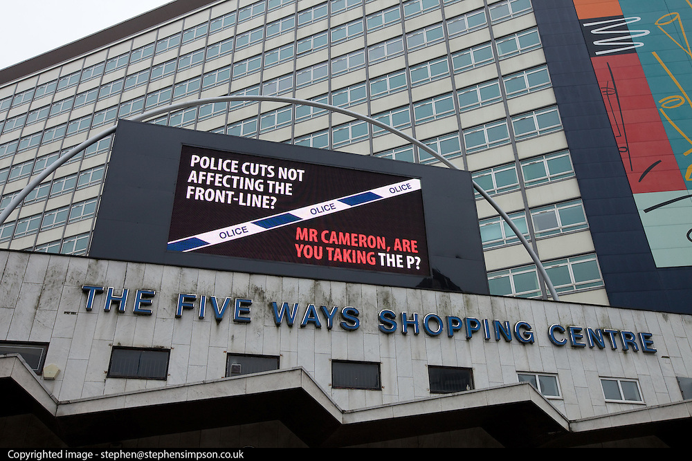 """© Licensed to London News Pictures. 08/10/2012 . Birmingham , UK . Police Federation advert outside the Five Ways Shopping Centre on Broad Street , Birmingham , which reads """" Police cuts not affecting the front-line? Mr Cameron , are you taking the P? """" . Conservative Party Conference Day 2 at the International Convention Centre . Photo credit : Joel Goodman/LNP"""