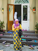 10 APRIL 2015 - BANGKOK, THAILAND: Thai Muslim women leave Ton Son Mosque in Bangkok after Friday mid day prayers. A Pew Research Center study recently released identified Islam as the fastest growing religion in the world. Masjid Ton Son was the first mosque in Bangkok, founded in 1688 during the reign of King Narai, of the Ayutthaya era. Muslims are about 5 percent of Thailand, but make up a bigger proportion of Bangkok. Thailand's deep south provinces are Muslim majority.    PHOTO BY JACK KURTZ
