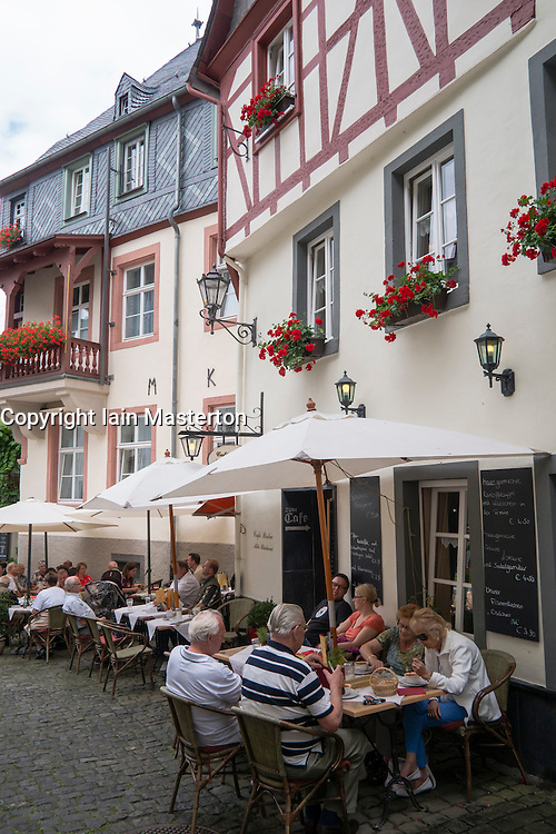 Medieval buildings with tourist cafes and restaurants in historic Beilstein village on River Mosel in Germany