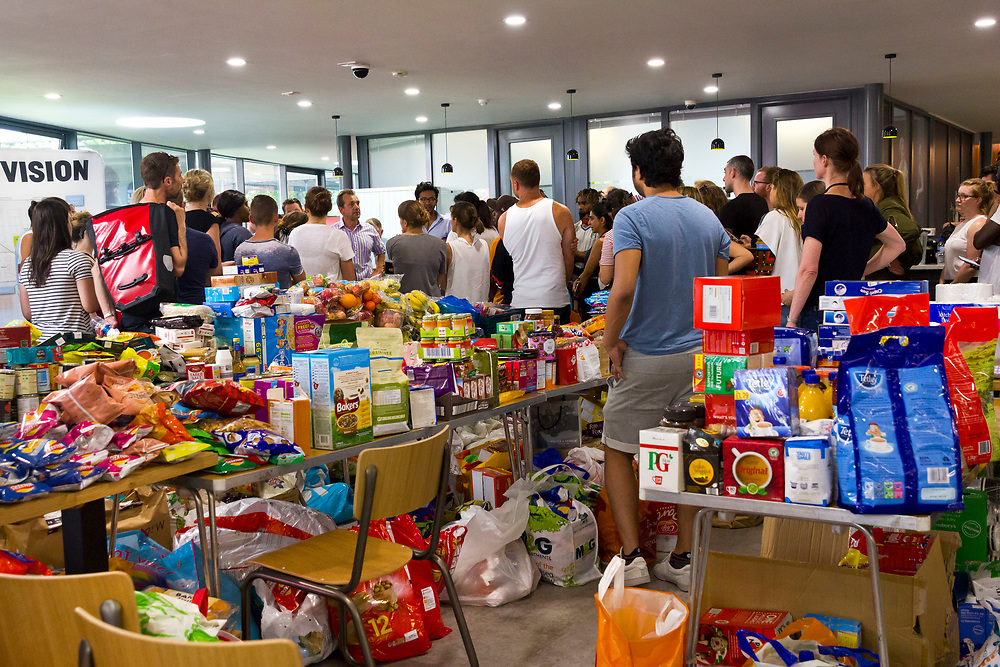 14 June 2017 taken between the hours of 14.51 - 16.24<br /> <br /> Inside Westway sports centre. Locals/charities and volunteers gather to help with organization within the centre.<br /> Emergency accommodation was created in the gym early in the morning and by 5pm it had mattresses donated from locals for 300 people.<br /> <br /> The Grenfell Tower fire occurred on 14 June 2017 at the 24-storey, 220-foot-high (67 m), tower block of public housing flats in North Kensington, Royal Borough of Kensington and Chelsea, West London. It caused at least 80 deaths and over 70 injuries.