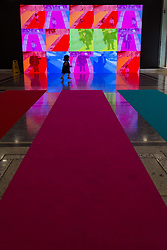 Canary Wharf, London, January 16 2018. A small girl plays in front of 'Colour Me Beautiful' by Tine Bech of Denmark at the Winter Lights festival at Canary Wharf in London which features over 30 spectacular light installations at interactive art. © Paul Davey