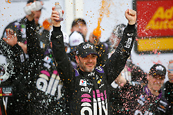February 10, 2019 - Daytona, FL, U.S. - DAYTONA, FL - FEBRUARY 10: Jimmie Johnson, driver of the #48 Ally Financial Chevy, celebrates a win in the Advance Auto Parts Clash on February 10, 2019 at Daytona International Speedway in Daytona Beach, FL. (Photo by David Rosenblum/Icon Sportswire) (Credit Image: © David Rosenblum/Icon SMI via ZUMA Press)