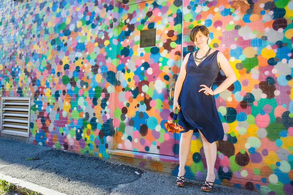 A bride and a colorful mural in downtown Waltham, MA.