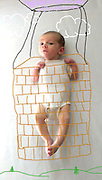 Baby boom!  pictures showing her baby son as anything from a soldier to Popeye<br /> <br /> When U.S.-based artist Amber Wheeler gave birth to her son she decided to incorporate him into her works - with hilarious results!<br /> Miss Wheeler's pictures have become an online hit after she used a white background and computer painting tools to create the heartwarming images of her son in a variety of different styles and personas.<br /> In one photograph the baby is a chef cooking in the kitchen, and in another he has a gun strapped to his chest, ready to go into battle.<br /> ©Amber Wheeler /Exclusivepix Media