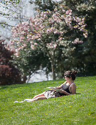 © Licensed to London News Pictures. 20/04/2015. Bristol, Avon, UK. A woman out enjoying the sunny weather in Bristol today, 20th April 2015. The South West of England is set for more warm temperatures and plenty of sunshine this week. Photo credit : Rob Arnold/LNP
