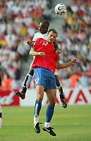 Photo: Chris Ratcliffe.<br /> Czech Republic v Ghana. Group E, FIFA World Cup 2006. 17/06/2006.<br /> Illiasu Shilla of Ghana clashes with Vratislav Lokvenc of the Czech Republic.