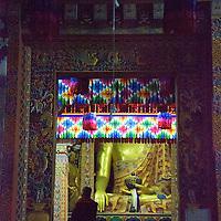 Asia, Bhutan, Thimpu. Monk at entry to Tashichhoedzong.
