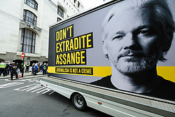 © Licensed to London News Pictures. 07/09/2020. LONDON, UK. A van displaying an image of Wikileaks founder Julian Assange passes by at a protest outside the Old Bailey as his extradition hearing, which is expected to last for the next three or four weeks, resumes after it was postponed due to the coronavirus pandemic lockdown.  Julian Assange is wanted in the US for allegedly conspiring with army intelligence analyst Chelsea Manning to expose military secrets in 2010.  Photo credit: Stephen Chung/LNP