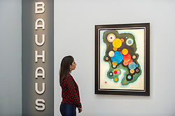 "© Licensed to London News Pictures. 20/02/2019. LONDON, UK. A staff member views ""Vertiefte Regung"", 1928, by Wassily Kandinsky, (Est. £5.5-7.5m). Preview of Sotheby's Impressionist & Modern and Surrealist Art sales.  The auction will take place at Sotheby's New Bond Street on 26 February 2019.  Photo credit: Stephen Chung/LNP"