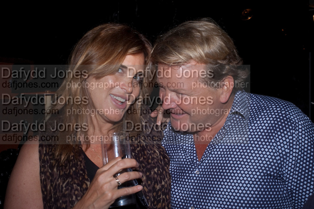 JULIAN OZANNE; JANINE DI GIOVANNI;, Book party for Janine di Giovanni's Ghosts by Daylight. Blake's Hotel. South Kensington. London. 12 July 2011. <br /> <br />  , -DO NOT ARCHIVE-© Copyright Photograph by Dafydd Jones. 248 Clapham Rd. London SW9 0PZ. Tel 0207 820 0771. www.dafjones.com.