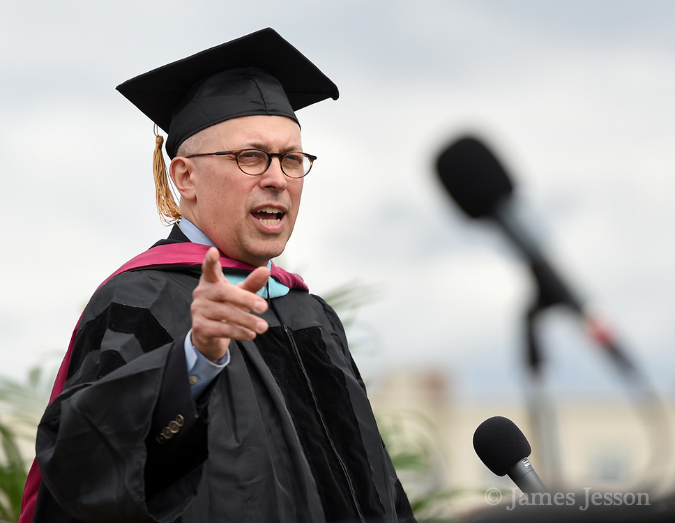 Arlington resident Jeff Thielman, chair of the Arlington School Committee, speaks during the graduation exercises for the Class of 2017 at the Warren A. Peirce Field in Arlington, June 3, 2017.   [Wicked Local Photo/James Jesson].