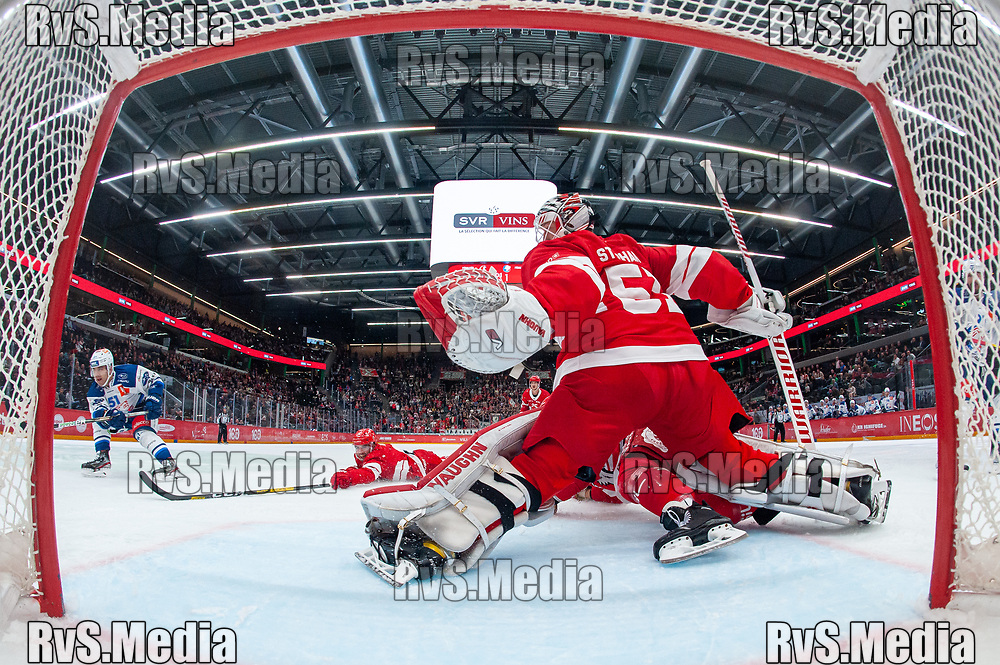 LAUSANNE, SWITZERLAND - OCTOBER 01: Justin Azevedo #51 of ZSC Lions tries to score against Goalie Tobias Stephan #51 of Lausanne HC during the Swiss National League game between Lausanne HC and ZSC Lions at Vaudoise Arena on October 1, 2021 in Lausanne, Switzerland. (Photo by Monika Majer/RvS.Media)
