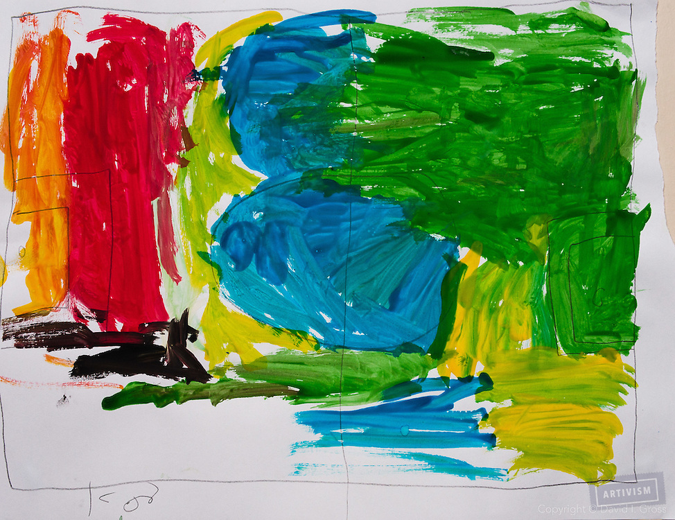 A soccer pitch filled with colors that show how the boy was feeling. Drawing by 10-12 yr old boy, from art session with the neighborhood boys--not from the school. Topic for session: what do you dream about or hope for?