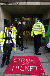 London, UK. 22nd January, 2019. A police officer and security guards outside the Ministry of Justice (MoJ) as receptionists, security guards and cleaners represented by the United Voices of the World (UVW) trade union begin a strike for the London Living Wage of £10.55 per hour and parity of sick pay and annual leave allowance with civil servants. The strike is being coordinated with support staff at the Department for Business, Energy and Industrial Strategy (BEIS) from the Public and Commercial Services (PCS) union.