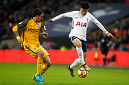 Son Heung-min of Tottenham Hotspur (R) under pressure from Ezequiel Schelotto of Brighton & Hove Albion (L).  Premier league match, Tottenham Hotspur v Brighton & Hove Albion at Wembley Stadium in London on Wednesday 13th December 2017.<br /> pic by Steffan Bowen, Andrew Orchard sports photography.