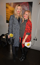 Left to right, Laura Whitmore and Erica Bergsmeds at an exhibition of photographs by Erica Bergsmeds held at The Den, 100 Wardour Street, London England. 19 January 2017.