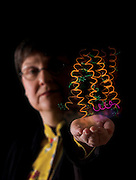 Photo illustration of Dr. Patricia Reggio holding a cannabinoid receptor. Photographed for a magazine cover.