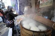 freshly made dumpling buns steaming on food stall  in Chinatown Yokohama Japan