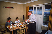 Self catering family having their evening meal at  Butlins Holiday camp, Skegness. Butlins Skegness is a holiday camp located in Ingoldmells near Skegness in Lincolnshire. Sir William Butlin conceived of its creation based on his experiences at a Canadian summer camp in his youth and by observation of the actions of other holiday accommodation providers, both in seaside resort lodging houses and in earlier smaller holiday campsThe camp began opened in 1936, when it quickly proved to be a success with a need for expansion. The camp included dining and recreation facilities, such as dance halls and sports fields. Over the past 75 years the camp has seen continuous use and development, in the mid-1980s and again in the late 1990s being subject to substantial investment and redevelopment. In the late 1990s the site was re-branded as a holiday resort, and remains open today as one of three remaining Butlins resorts.