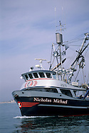 Commercial fishing boats enter Santa Barbara Channel from Channel Islands Harbor, Oxnad, Ventura County, California