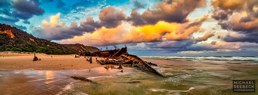 A spectacular golden sunset captured from the Maheno Wreck on 75 mile beach on Fraser Island.<br /> <br /> Code: AAQR0001<br /> <br /> 2.7:1 Panoramic Print. Available in 40in (100cm) to 70in (178cm) sizes. ('Image Size' below not indicative of print size and resolution.)<br /> <br /> Limited Edition of 50 only.<br /> <br /> Add to Cart to view print options and pricing.