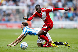 Albert Adomah of Middlesbrough gets away from Jack Robinson of Huddersfield - Photo mandatory by-line: Rogan Thomson/JMP - 07966 386802 - 13/09/2014 - SPORT - FOOTBALL - Huddersfield, England - The John Smith's Stadium - Huddersfield town v Middlesbrough - Sky Bet Championship.