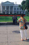 Tourists and locals enjoy the closing of the section of Pennsylvania Ave. in front of the White House.