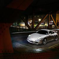 Porsche 997 Carrera S on a bridge in foggy London.