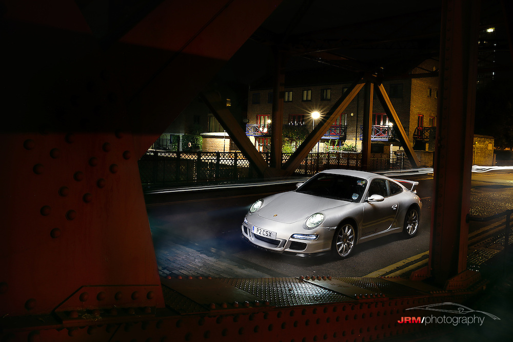 Porsche 997 Carrera S on a bridge in foggy London.