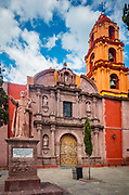"""The San Francisco Church in the historic center of San Miguel de Allende, Mexico<br /> ------<br /> The San Francisco Church was begun in 1778 and was finished more than twenty years later, when architectural styles were changing. The façade is pure Churrigueresque with stone figures and fine columns. The later bell tower was constructed in 1799 in Neoclassical style by architect Francisco Eduardo Tresguerras.<br /> <br /> San Miguel de Allende is a city and municipality located in the far eastern part of the state of Guanajuato in central Mexico. It is part of the macroregion of Bajío. Historically, the town is important as being the birthplace of Ignacio Allende, whose surname was added to the town's name in 1826, as well as the first municipality declared independent of Spanish rule by the nascent insurgent army during the Mexican War of Independence. However, the town waned during and after the war, and at the beginning of the 20th century was in danger of becoming a ghost town. Its Baroque/Neoclassical colonial structures were """"discovered"""" by foreign artists who moved in and began art and cultural institutes such as the Instituto Allende and the Escuela de Bellas Artes. This gave the <br /> This attracted foreign art students, especially former U.S. soldiers studying on the G.I. Bill after the Second World War. Since then, the town has attracted a significant amount of foreign retirees, artists, writers and tourists, which is shifting the area's economy from agriculture and industry to commerce catering to outside visitors and residents. The main attraction of the town is its well-preserved historic center, filled with buildings from the 17th and 18th centuries. This and the nearby Sanctuary of Atotonilco have been declared World Heritage Sites in 2008."""