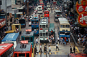 While still a British colony, heavy 1990s traffic of cars, trams and buses, on 21st April 1995, in Central, Hong Kong, China.