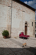 Little red three wheeled Piaggio vehicle in Trevi, Umbria, Italy. Trevi is an ancient town and comune on the lower flank of Monte Serano.