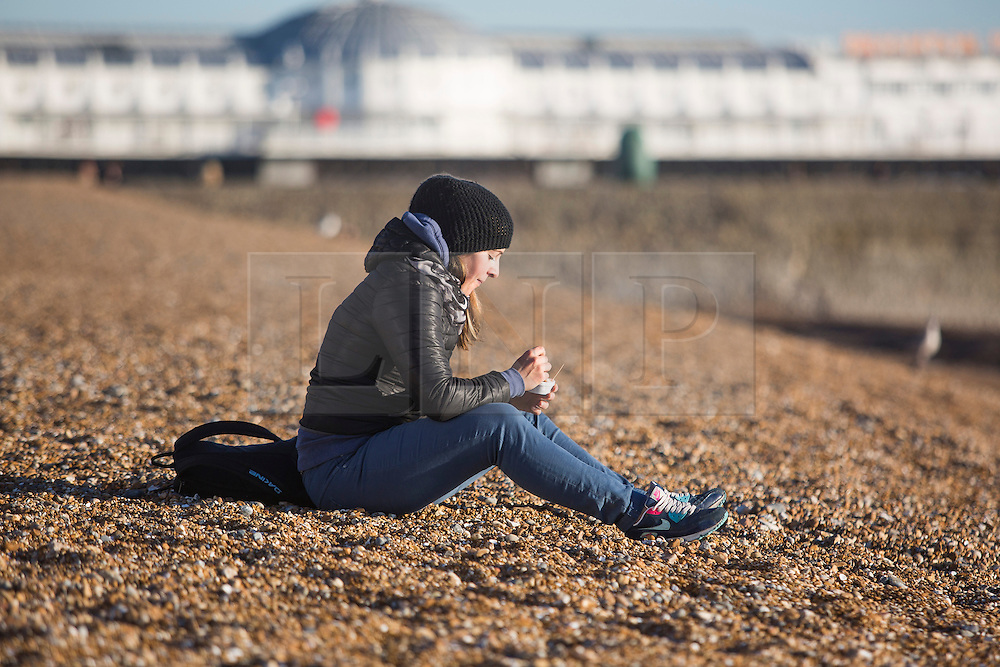 Brighton, UK. 30/11/2016, Members of the public take advantage of the mild and sunny weather to relax on the beach in Brighton.  Photo Credit: Hugo Michiels