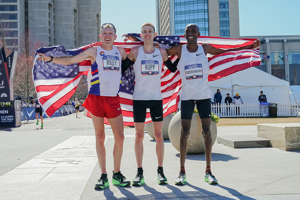 Winners of the the 2020 U.S. Olympic marathon trials in Atlanta on Saturday, Feb. 20, 2020. From left: Jacob Riley (second place), Galen Rupp (first place) and Abdi Abdirahman (third place). Photo by Kevin D. Liles for The New York Times