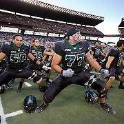University of Hawaii football players perform a traditional Polynesian tribal chant.
