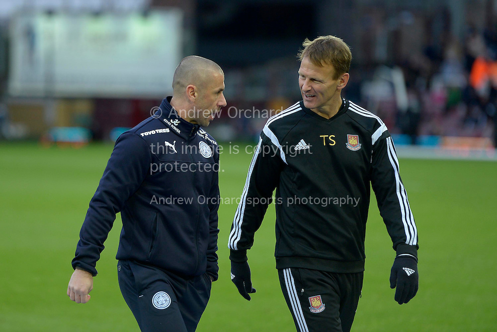 ex England player Teddy Sheringham, the West Ham United attacking coach talking to ex England Kevin Phillips, the Leicester City first team coach. Barclays Premier league match, West Ham Utd v Leicester city at the Boleyn ground, Upton Park in London on Sat 20th December 2014.<br /> pic by John Patrick Fletcher, Andrew Orchard sports photography.