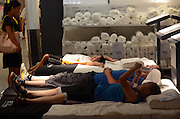 BEIJING, CHINA - AUGUST 06: (CHINA OUT) <br /> <br /> People have a rest at an IKEA store<br /> <br /> People have a rest at an IKEA store on August 6, 2013 in Beijing, China. Many people just come to the IKEA store to enjoy the air-conditioning on a hot summer day and take a nap on the comfy furniture on display. The company hasn't taken any measures against people making themselves at home, because it sees it as a future investment. <br /> ©Exclusivepix