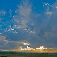 The sun sets over Montana's Gallatin Valley, near Bozeman.  (Photographed from Eagle Rock subdivision.