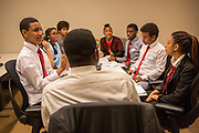 Purchase, NY – 31 October 2014. Students from Early College High School working on their case wth Morgan Stanley facilitator Ken  Farrell.  The Business Skills Olympics was founded by the African American Men of Westchester, is sponsored and facilitated by Morgan Stanley, and is open to high school teams in Westchester County.