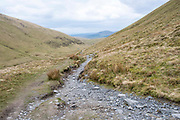 A rugged footpath along the Scales Beck valley along Blencathra Mountain, Lake District, Cumbria, UK.