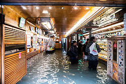 October 29, 2018 - Venice, Italy - Shopping in flooded market place. Weather emergency In Venice, italy, on 29 October 2018 due to the High water: almost all the city have been underwater with a maximum level reached of 160cm on the sea level. (Credit Image: © Giacomo Cosua/NurPhoto via ZUMA Press)