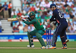 Bangladesh's Tamim Iqbal flicks the ball away during the ICC Champions Trophy, Group A match at The Oval, London.