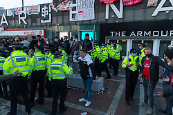 © Licensed to London News Pictures.  23/04/2021. London, UK. Police attempt to disperse Arsenal fans who gathered at the Emirates Stadium in North London to protest against the European Super League and general running of the club. Photo credit: Marcin Nowak/LNP