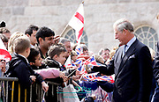 Pictured are visitors and pupils from Birmingham welcoming the arrival of HRH Prince Charles the Prince of Wales and his wife Camila the Duchess of Cornwall. He is pictured talking to a pupils from pupils from St Edwards Catholic School in Selly Park Birmingham. They are opening Birmingham's refurbished Town Hall<br /> Picture by  Shaun Fellows/ www.shinepix.co.uk