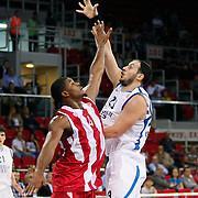 Anadolu Efes's Ermal KURTOGLU (R) and Olympiacos's Kyle HINES (L) during their Two Nations Cup basketball match Anadolu Efes between Olympiacos at Abdi Ipekci Arena in Istanbul Turkey on Sunday 02 October 2011. Photo by TURKPIX