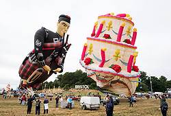 © Licensed to London News Pictures. 11/08/2018. Bristol, UK. Bristol International Balloon Fiesta. The morning mass ascent taking place on Saturday morning after the previous mass ascents were cancelled due to weather conditions, at the Bristol International Balloon Fiesta 2018 at Ashton Court estate which runs from Thursday 09 to Sunday 12 August. This year is the event's 40th anniversary and includes some special shape balloons that have not been seen for years, including Rupert the Bear, the giant motorbike, and the Scottish Piper. Photo credit: Simon Chapman/LNP