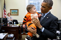 President Barack Obama stops by the Chief of Staff's office in the West Wing of the White House to visit with children of staff dressed up for the annual Halloween Party in the Eisenhower Executive Office Building, Oct. 24, 2014. (Official White House Photo by Pete Souza)<br /> <br /> This official White House photograph is being made available only for publication by news organizations and/or for personal use printing by the subject(s) of the photograph. The photograph may not be manipulated in any way and may not be used in commercial or political materials, advertisements, emails, products, promotions that in any way suggests approval or endorsement of the President, the First Family, or the White House.