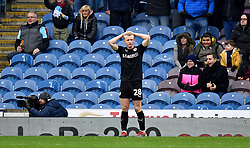 Barnsley's Ben Williams appears dejected after Burnley's Chris Wood scores his side's first goal of the game during the Emirates FA Cup, third round match at Turf Moor, Burnley.