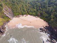 Aerial view of secluded butterfly beach on a bright sunny day in south of goa, India.
